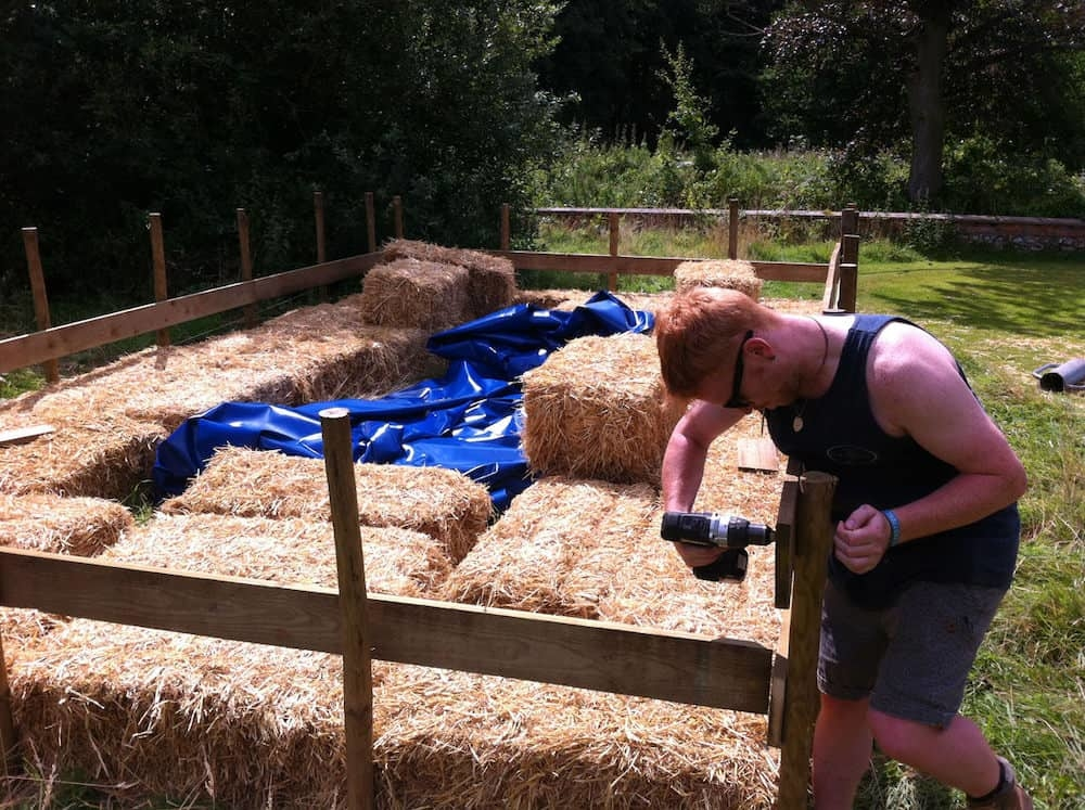 Building the swimming pool from Hay Bales at the Farmhouse Sessions festival