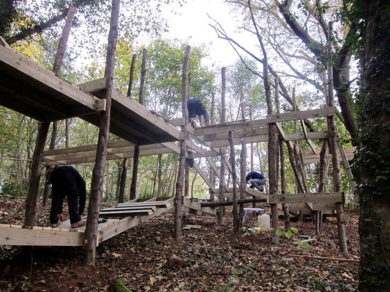 The team work on the slopes of the Culzean Castle site and build the play structures to follow the contours