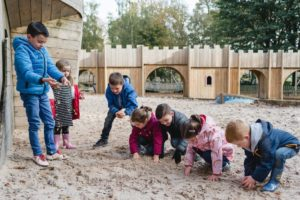 Playing together in the sand at Culzean Castle Adventure play