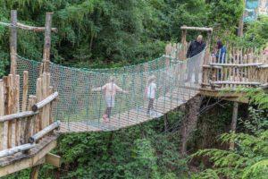 Walking over the rope bridge at Brodick Castle Isle Be Wild Adventure Play Arran