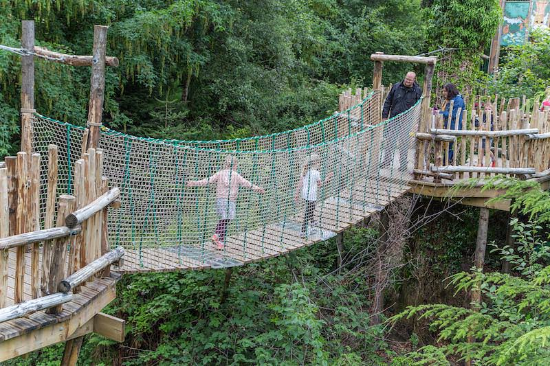 Walking over the rope bridge at Brodick Castle Isle Be Wild Adventure Play Arran