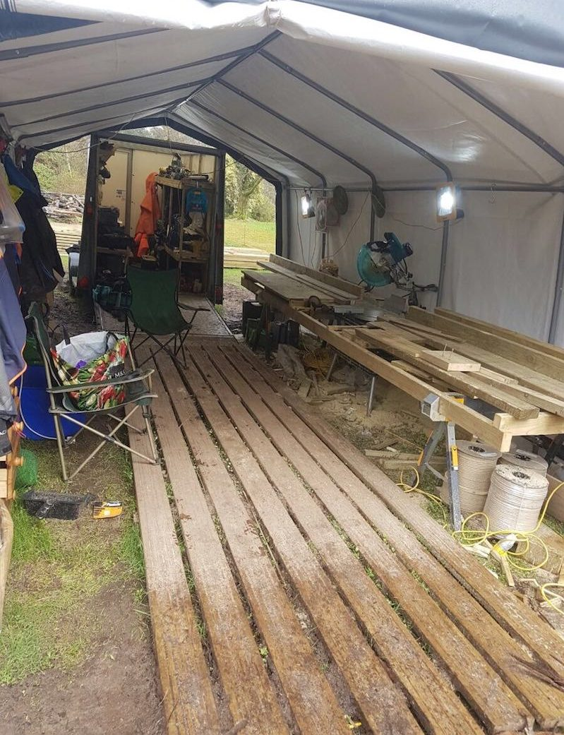 The reality of working on site is a tent over the saw and a lock up trailer