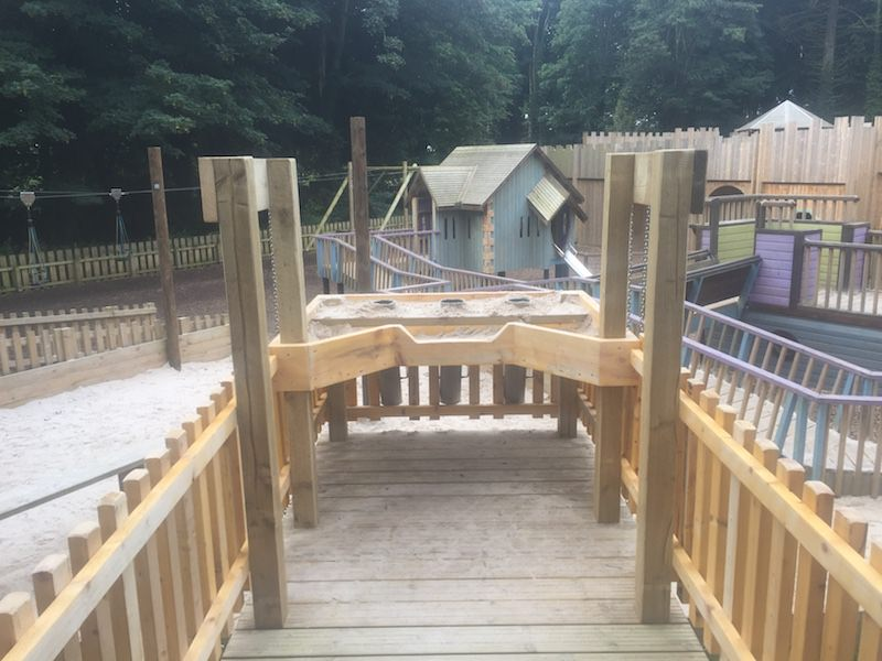 Wheelchair accessible play for a sand table from above showing the pulleys to bring sand to the top