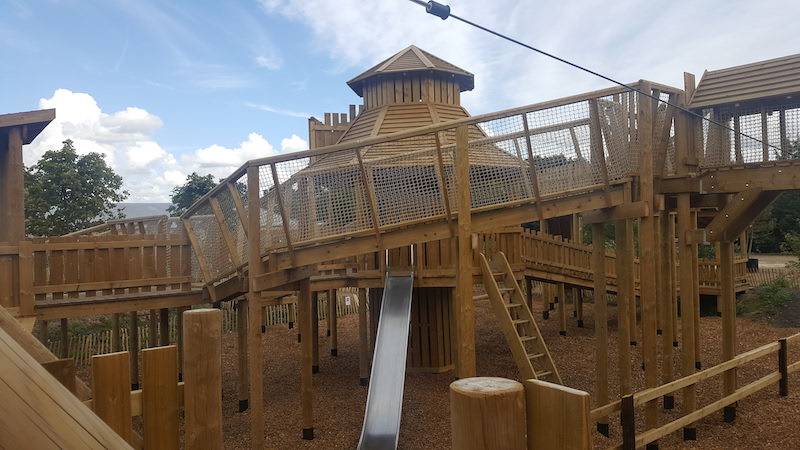 Detail of the new outdoor Adventure Play at Chobham Adventure Farm showing the central treehouse and slide.
