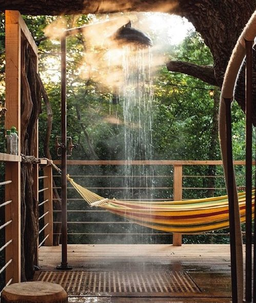 Steaming shower inside treehouse accommodation