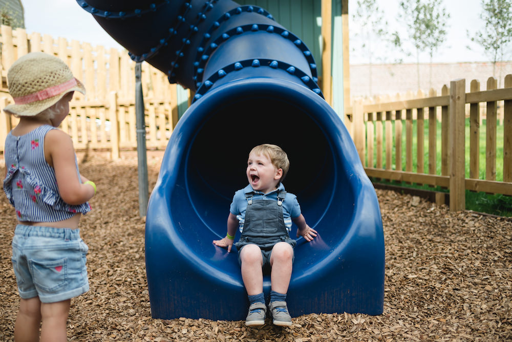 There's a big slide for kids at Newhailes adventure play by CAP.Co