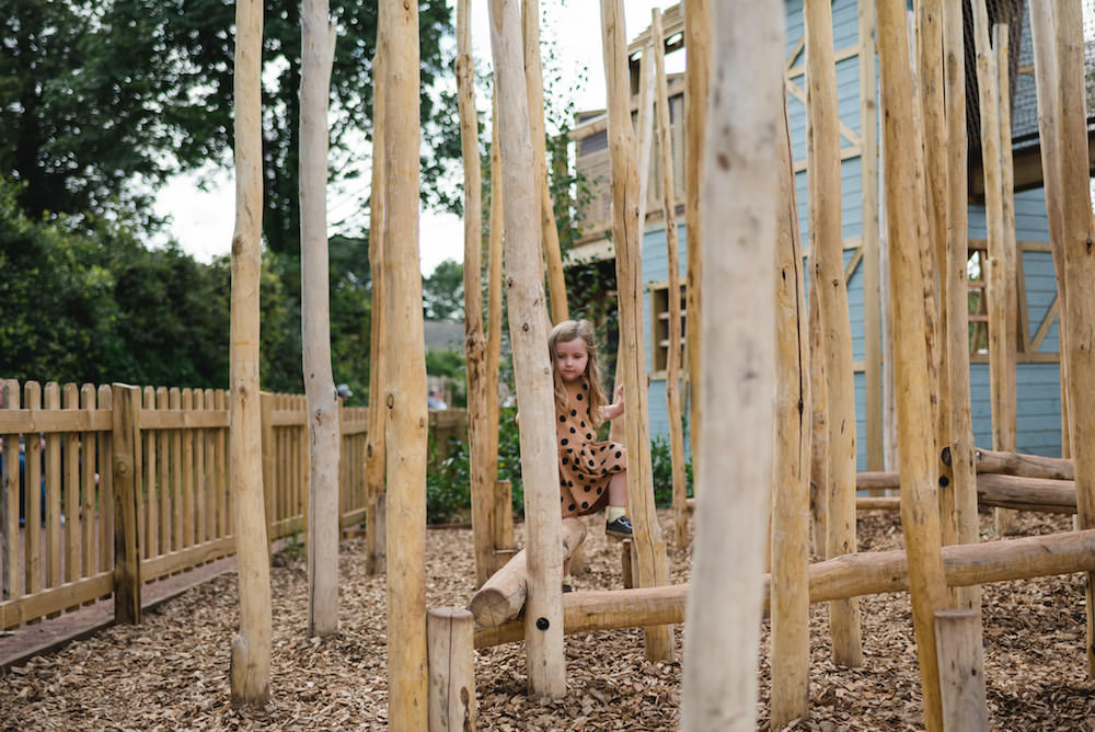 climbing through a pole forest at Weehailes adventure play by CAP.Co at Newhailes