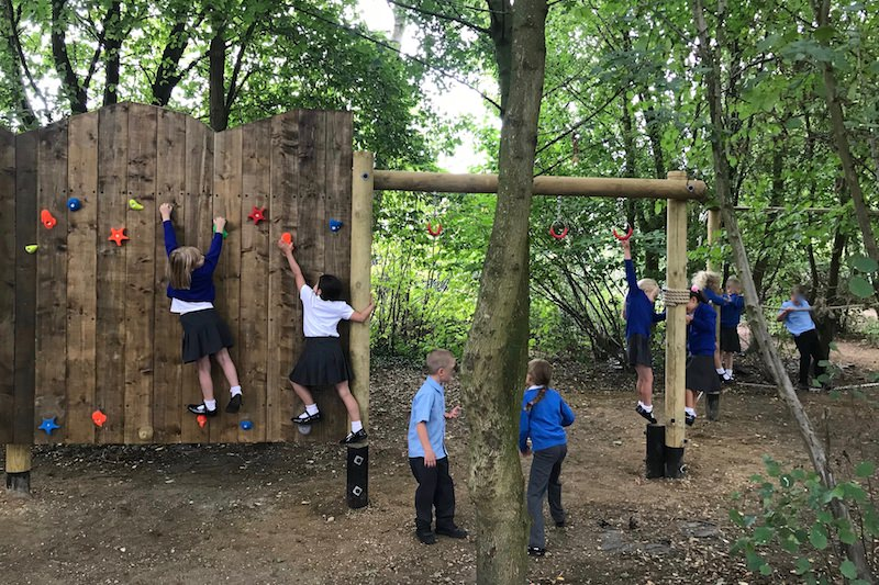 The kids playing on the new adventure play at Poringland School lead image