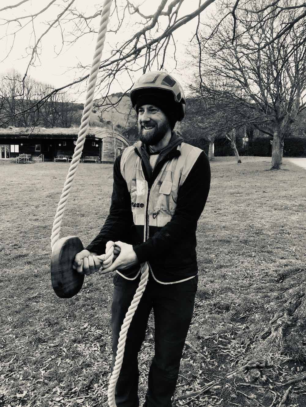 Joe Hallam of CAP.Co installs the new swing at Kingston Village Green