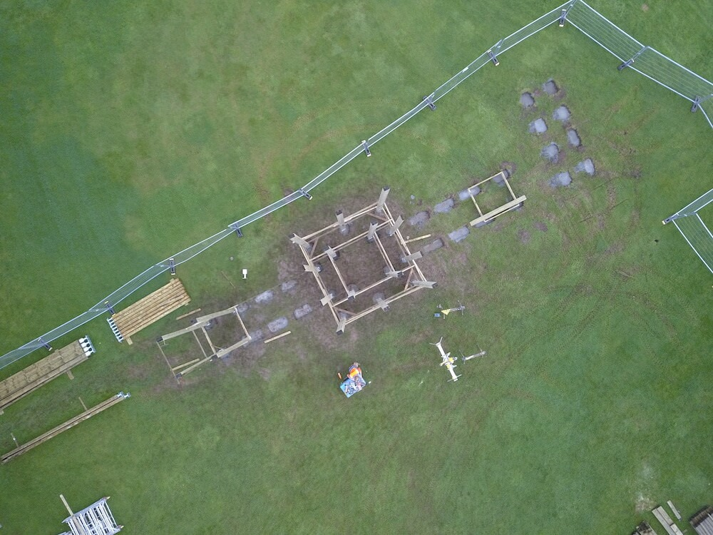 Crieff Hydro Adventure play in build aerial shot first vertical poles are installed