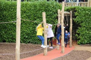 The explorers make their way through the hedgerows into another play zone