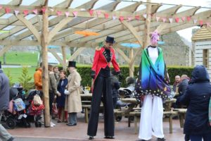 The stiltwalkers make their presence known as they tower over the guests