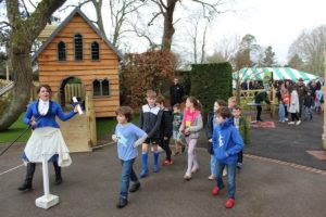 The Toastmaster welcomes the children into the new play area
