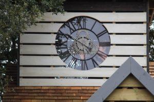 The children peer through the clock inside the clocktower