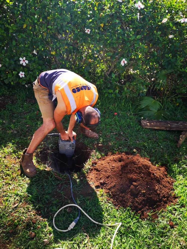 Digging holes for posts in the sun in Bermuda