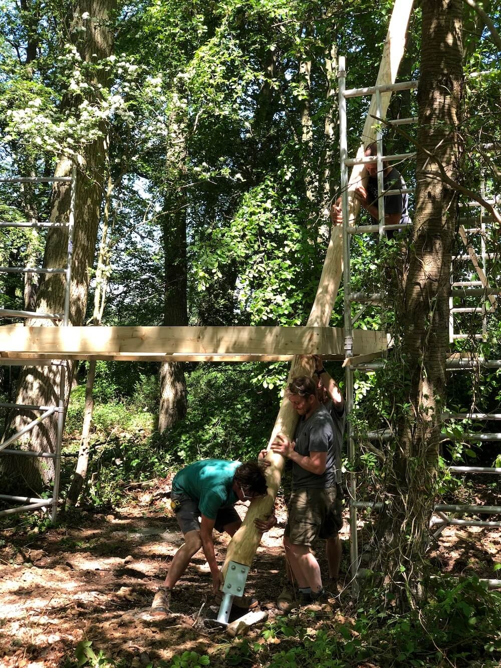 Installing a pole on site for Adventure play