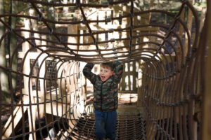 Clamber through the nets to reach the slides at Tumblestone Hollow in Oxon