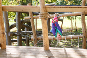 Places to swing and hang upside down within Tumblestone Hollow adventure Play at Stonor Park Oxfordshire